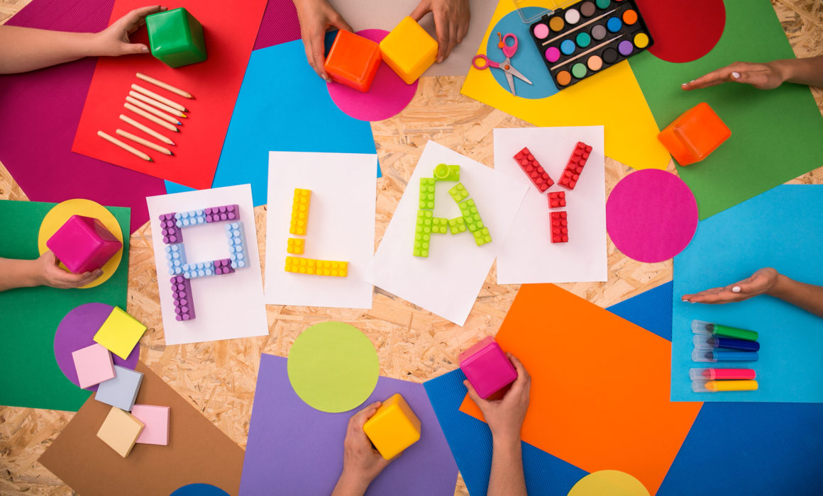 Children and parents playing together to help them be happy and calm through play